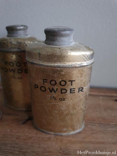 Oud blikje footpowder.